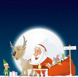 Santa, elf and reindeer in the North Pole Stock Photography