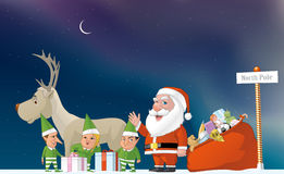 Santa, elfs and reindeer in the North Pole Stock Images