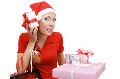 Santa elper with many gifts Stock Photos
