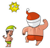 Santa and elves beach holiday Stock Photos