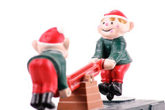 Santa Elves Playing. On Train Stock Photo