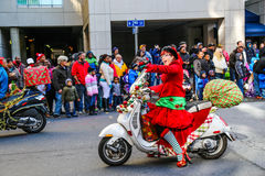 Santa Elves Riding Scooters in Holiday Parade Stock Images