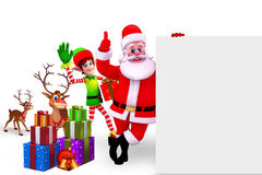 Santa with elves standing near sign Stock Photography