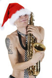 Santa embraces a saxophone Royalty Free Stock Image
