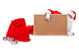 Santa and empty bulletin board Stock Images