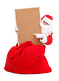 Santa and empty bulletin board Royalty Free Stock Images