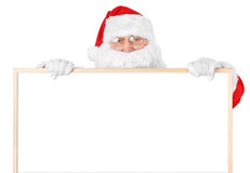 Santa and empty white board over white Stock Photos
