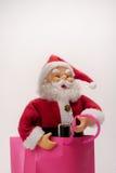 Santa en un bolso Fotografía de archivo