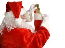 Santa enche a meia imagem de stock