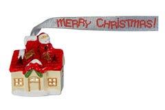 Santa engraçada está sentando-se no telhado imagens de stock royalty free