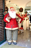 Santa at entrance to christmas decorations store Stock Photo