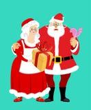 Santa et ornements ou graphismes de Mrs Claus a isolé Noël Family Femme dans le Dr. rouge Images stock