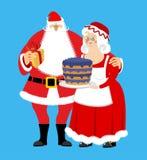 Santa et ornements ou graphismes de Mrs Claus a isolé Noël Family Femme dans le Dr. rouge Image libre de droits