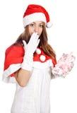 Santa et un cadeau photographie stock libre de droits