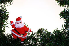 Santa on Evergreen Border Stock Photo