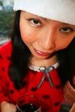 santa för asiatisk hatt slitage kvinna Arkivfoton