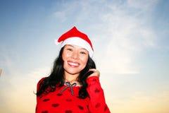 santa för asiatisk hatt slitage kvinna Arkivbild