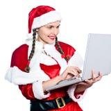 santa för julclaus dator kvinna Royaltyfri Foto