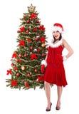 santa för julflickahatt tree Arkivbild