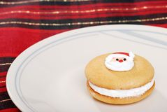 Santa face cookie on plate Stock Images