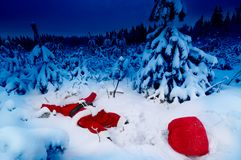 Santa fallen into snow. Santa lying in the snow with his presents sack near him Royalty Free Stock Photography