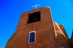 Santa Fe Church. Historic adobe church in Santa Fe, New Mexico against a blue sky Royalty Free Stock Images