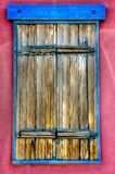 Santa Fe Colorful Window Frame and Doors. Antique frame and sashes in beautiful blue and Mauve framing Royalty Free Stock Photo