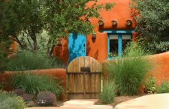 Santa Fe cottage. Orange adobe Santa Fe cottage and garden gate Royalty Free Stock Image