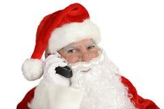 Santa felice sul telefono Fotografia Stock