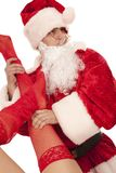 Santa with female legs in red stockings Royalty Free Stock Image
