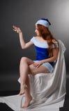 Santa femenino con el pequeño reloj. imagen de archivo libre de regalías