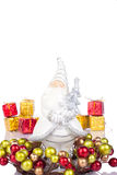 Santa figure. Santa claus figure in coronet, gifts in background Royalty Free Stock Image