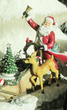 Santa figure. Christmas and New Years decoration. Santa small figure with candy and presents, a small deer Royalty Free Stock Photo