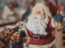 Santa figurine closeup with blurred background. royalty free stock image