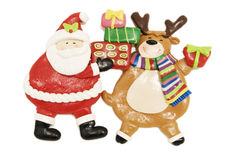 Santa figurine and Rudolph the red-nosed reindeer Royalty Free Stock Photography