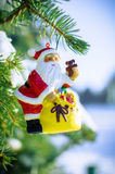 Santa on fir tree with snow outside Royalty Free Stock Photos