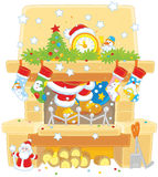 Santa in the fireplace Stock Images