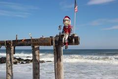 Santa Fisherman On The Ocean Royalty Free Stock Photography