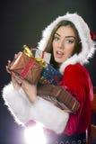 Santa flicka med julgåvor. royaltyfri fotografi