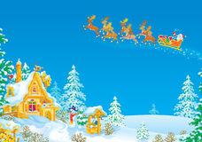 Santa flies in the sledge with reindeers. Santa Claus with the Christmas gifts drives in the sledge with reindeers across the sky over the snow-covered house and Royalty Free Stock Photos