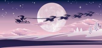 Santa flying in his sled Stock Photo