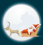 Santa flying in his sledge Stock Photography