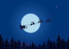 Santa flying through the night sky under the christmas forest. Santa sleigh driving over line drawing woods  Royalty Free Stock Photos