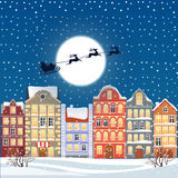 Santa flying through the night sky under the christmas old town illustration. Cartoon buildings background. City street Royalty Free Stock Photo
