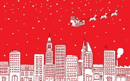 Santa flying over the city Stock Image