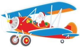 Santa flying a plane Stock Photo