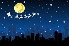 Santa Flying with sledge on Night City Royalty Free Stock Photography