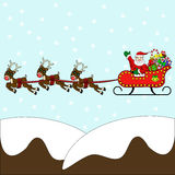 Santa flying in sleigh with reindeer. Waving Santa Claus flying in his sleigh, packed with presents and gifts, over snow capped mountains with red nosed reindeer Royalty Free Stock Image
