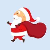 Santa fonctionnant avec le sac Photographie stock libre de droits