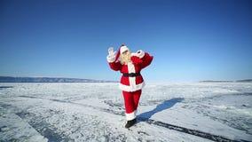 Santa Forgot a Bag With Gifts. Christmas holidays, Santa Claus walks around the lake Baikal, Siberia stock video footage